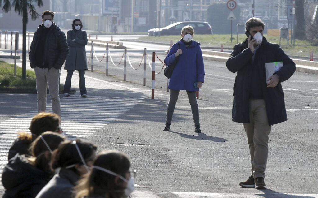 Northern Italian towns locked down after two die from virus