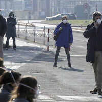 Workers wear masks at the Unilever factory where a 38-year-old working in the research and development branch fall ill with the new virus from China, in Casalpusterlengo, Northern Italy, Saturday, Feb. 22, 2020. (AP/Luca Bruno)