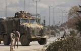 Turkish military convoy drives in Idlib province, Syria, Saturday, Feb. 22, 2020. (AP/Ghaith Alsayed)