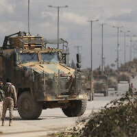 Turkish military convoy drives in Idlib province, Syria, Saturday, Feb. 22, 2020. (AP/Ghaith Alsayed)