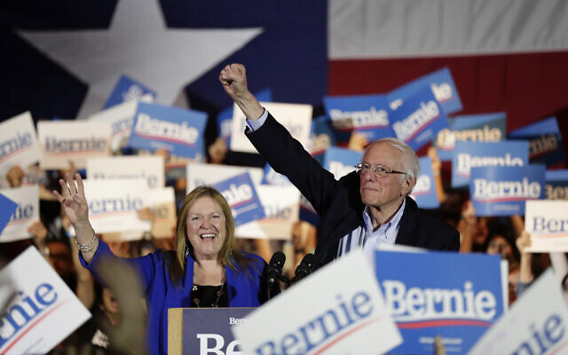 Democratic presidential candidate Sen. Bernie Sanders, I-Vt., right, with his wife Jane, raises his hand as he speaks during a campaign event in San Antonio, Saturday, Feb. 22, 2020. (AP/Eric Gay)