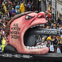 A carnival float depicts a racist with a gun in his mouth , reading 'from words to action' during the traditional carnival parade in Duesseldorf, Germany, on February 24, 2020. (Martin Meissner/AP)