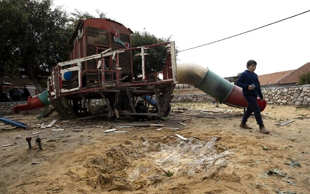 A bay walks inside a kindergarten's playground that was hit by a missile fired from the Gaza Strip in the city of Sderot, Israel, February 24, 2020. (AP Photo/Tsafrir Abayov)