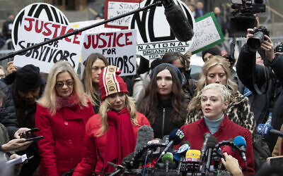 In this Jan. 6, 2020, file photo, Actor Rose McGowan, right, speaks at a news conference as actor Rosanna Arquette, center left, listens outside a Manhattan courthouse after the arrival of Harvey Weinstein in New York. (AP Photo/Mark Lennihan, File)