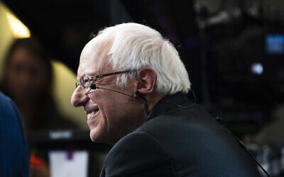 Democratic presidential candidate Sen. Bernie Sanders speaks with members of the media after a Democratic presidential primary debate, Feb. 25, 2020, in Charleston, S.C. (AP Photo/Matt Rourke)