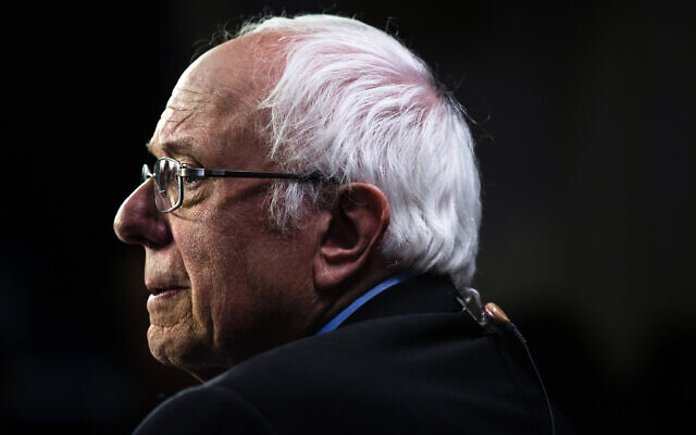 Democratic US presidential candidate Senator Bernie Sanders speaks with members of the media after a Democratic presidential primary debate, February 25, 2020, in Charleston, South Carolina. (AP Photo/Matt Rourke)