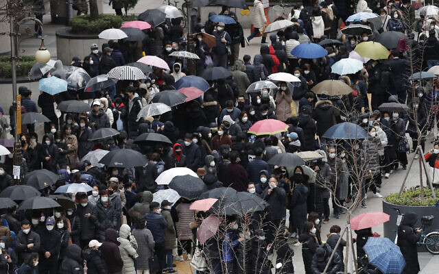 People line up to buy face masks to protect themselves from the new coronavirus outside a department store in Seoul, South Korea, Feb. 28, 2020. (AP Photo/Lee Jin-man)