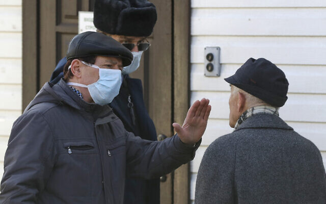A security guard forbids access for visitors to the hospital for infectious diseases, in Minsk, Belarus, Feb. 28, 2020 (AP Photo/Sergei Grits)