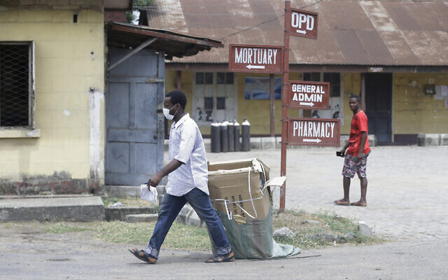 A man wearing face mask walks at the Yaba Mainland hospital where the first Nigerian victims of the COVID-19 virus are being treated in Lagos, Nigeria, Feb. 28, 2020 (Sunday Alamba via AP)