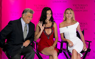 Chief Marketing Officer Ed Razek and Victoria's Secret models Candice Swanepoel and Adriana Lima during a press conference at the Victoria's Secret New Bond Street store in central London, April 15, 2014 (John Phillips/Invision/AP)