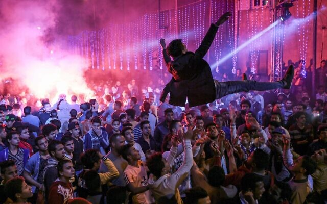 In this March 5, 2015 photo, youth dance at a local wedding in Salam City, a suburb on the outskirts of Cairo, to Mahraganat music. (AP Photo/Mosa'ab Elshamy)