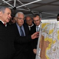 Prime Minister Benjamin Netanyahu. left, US Ambassador to Israel David Friedman, center, and then-Tourism Minister Yariv Levin during a meeting to discuss mapping extension of Israeli sovereignty to areas of the West Bank, held in the Ariel settlement, February 24, 2020. (David Azagury/US Embassy Jerusalem)