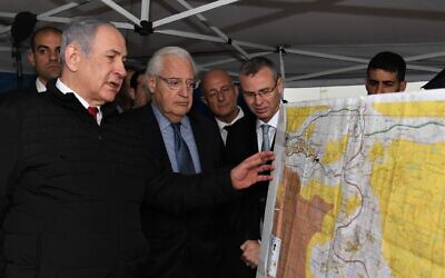 Prime Minister Benjamin Netanyahu, left, US Ambassador to Israel David Friedman, center, and then-Tourism Minister Yariv Levin during a meeting to discuss mapping extension of Israeli sovereignty to areas of the West Bank, held in the Ariel settlement, February 24, 2020. (David Azagury/US Embassy Jerusalem)