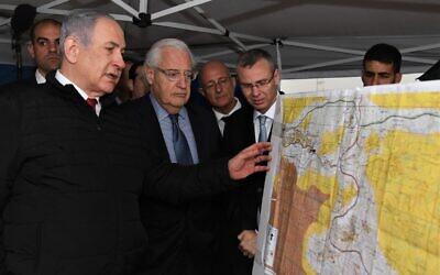 Prime Minister Benjamin Netanyahu (L) and US Ambassador to Israel David Friedman (2nd-L) at the northern West Bank settlement of Ariel on February 24, 2020. (David Azagury/US Embassy Jerusalem)