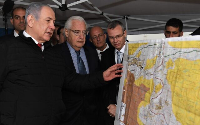 Prime Minister Benjamin Netanyahu (L) and US Ambassador to Israel David Friedman (2nd-L) at the northern West Bank settlement of Ariel on February 24, 2020. (David Azagury/US Embassy Jerusalem)
