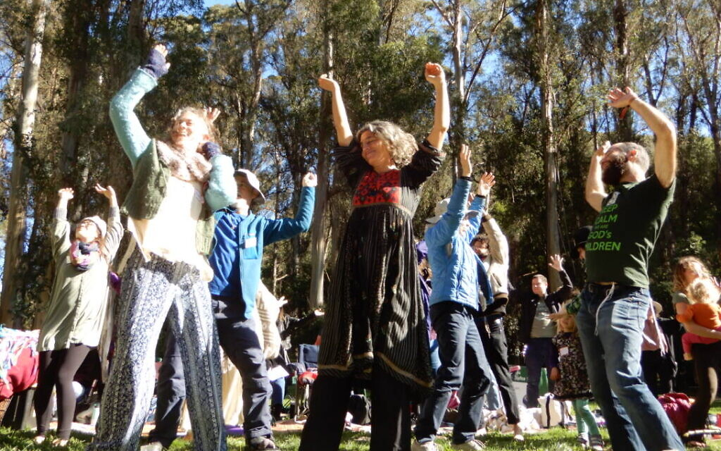 Participants celebrate Tu B'Shvat at a Wilderness Torah/JeWitch Collective event outside of San Francisco on February 9, 2020. (Melanie Lidman/Times of Israel)