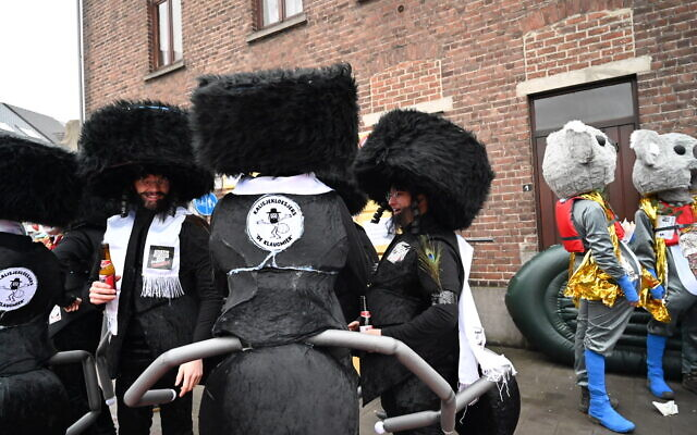 Participants of the Aalst Carnival wearing costumes combining ultra-Orthodox Jewish attire with ant limbs at the event in Aalst, Belgium on February 23, 2020. (Cnaan Liphshiz)