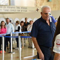 Illustrative: Medical personnel check travelers arriving at the Tel Aviv Ben Gurion Airport from Cairo for the Ebola viruson October 20, 2014. (Flash90)