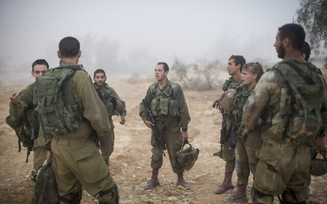 Illustrative. Soldiers of the Bardales Battalion listen to their commander during a training exercise in southern Israel, on July 13, 2016. (Hadas Parush/Flash90)