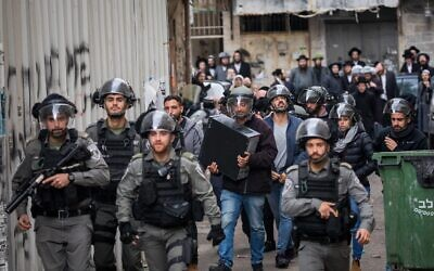 Police officers seen during a raid on offices in the Mea Shearim neighborhood in Jerusalem on December 2, 2019. (Yonatan Sindel/Flash90)