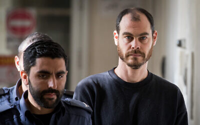 Israeli activist Jonathan Pollak, right, seen in the Magistrate's Court in Jerusalem, January 15, 2020. (Yonatan Sindel/Flash90)