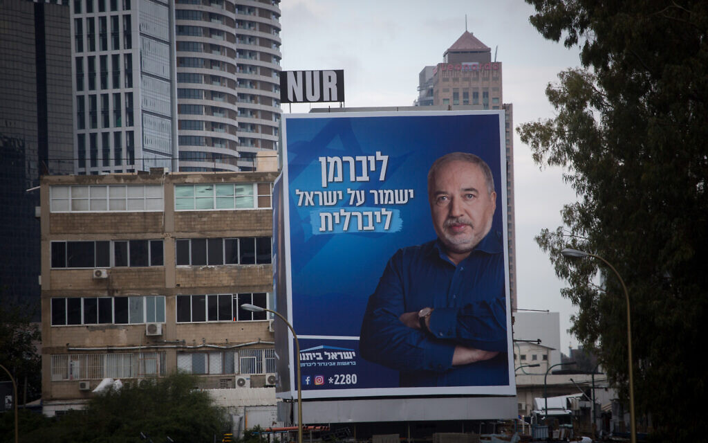 "A campaign poster for the Yisrael Beytenu party features the image of leader Avigdor Liberman and the caption, ""Liberman will keep Israel liberal,"" along the Ayalon highway in Tel Aviv, January 21, 2020. (Miriam Alster/Flash90)"