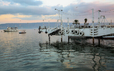 View of the Sea of Galilee as it seen from the beach promenade in the Northern Israeli city of Tiberias, on January 30, 2020. (David Cohen/Flash90)