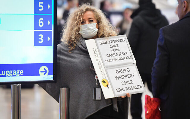 A woman wears a facemask at Ben Gurion International Airport on February 2, 2020. (Avshalom Shoshani/Flash90)