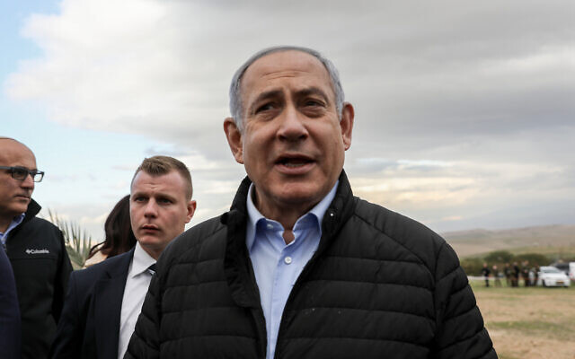 Prime Minister Benjamin Netanyahu at a tree planting event for the Jewish holiday of Tu Bishvat in the West Bank settlement of Mevo'ot Yericho, in the Jordan Valley, February 10, 2020. (Flash90)