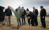 Prime Minister Benjamin Netanyahu plants a tree during an event for the Jewish holiday of Tu Bishvat, in the West Bank settlement of Mevo'ot Yeriho, in the Jordan Valley, February 10, 2020. (Flash90)