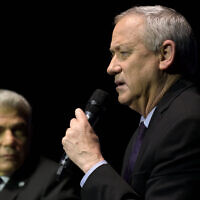 Blue and White Chairman Benny Gantz (R) and party no. 2 Yair Lapid at an election event hosted by the Tel Aviv International Salon, Tel Aviv, February 17, 2020. (Gili Yaari/Flash90)