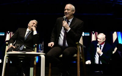 Blue and White head Benny Gantz (right), with his party No.2 Yair Lapid, at an election event in Tel Aviv, Feb 17, 2020. (Tomer Neuberg / Flash90)