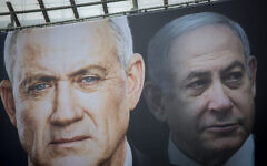Election posters hung by the Blue and White party shows their candidate Benny Gantz and Prime Minister Benjamin Netanyahu on February 18, 2020. (Miriam Alster/FLASH90)