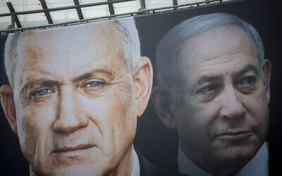 Election posters put up by Blue and White show candidates Benny Gantz (left) and Benjamin Netanyahu on February 18, 2020. (Miriam Alster/Flash90)