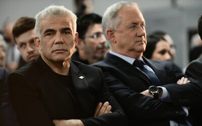 Yair Lapid (left) and Benny Gantz speak to supporters in Tel Aviv, on February 20, 2020. (Tomer Neuberg/Flash90)