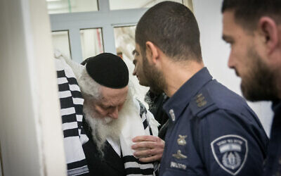 Rabbi Eliezer Berland arrives for a court hearing at the Magistrate's Court in Jerusalem, on February 20, 2020. (Yonatan Sindel/Flash90 )