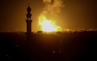 A ball of fire and smoke rises above buildings during Israeli airstrikes in Rafah in the southern Gaza Strip on February 23, 2020. (Abed Rahim Khatib/Flash90)