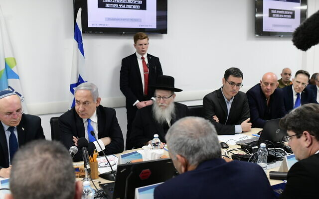 Prime Minister Benjamin Netanyahu (2nd-L) and Health Minister Yaakov Litzman (3rd-L) attend a situational assement on the coronavirus at the Health Ministry in Tel Aviv on February 23, 2020. (Tomer Neuberg/Flash90)