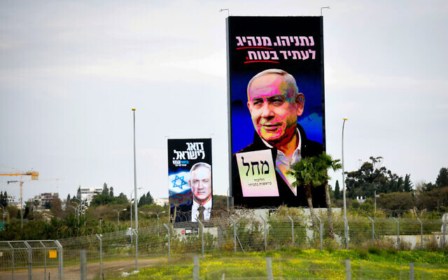 Election campaign billboards for Likud and Prime Minister Benjamin Netanyahu (R) and Blue and White chairman Benny Gantz, in Tel Aviv on February 24, 2020. (Flash90)