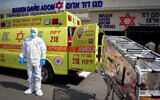 Magen David Adom worker wears protective clothing as a preventive measure against the coronavirus outside the special emergency Call Center in Kiryat Ono on February 26, 2020 (Flash90)