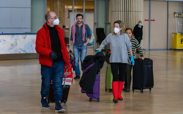 People wearing face masks at Ben Gurion International Airport on February 27, 2020. (Photo by Flash90)