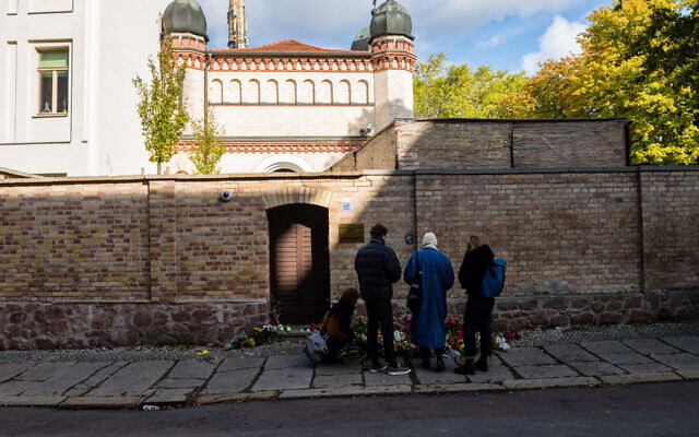 Visitors at the synagogue in Halle the day after a gunman targeted the house of worship in eastern Germany, October 10, 2019. (Jens Schlueter/Getty Images/via JTA)