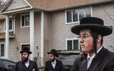 People gather in front of the Monsey house of Rabbi Chaim Rottenberg, the site of an attack at a Hanukkah party by a machete-wielding man, Dec. 29, 2019. (Stephanie Keith/Getty Images via JTA)