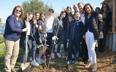 Isaac Herzog (2R) and Hagit Cohen-Hamo (R), mother of Ori Hamond, the lone soldier from San Diego injured in a ramming attack in Jerusalem on Feb. 6, plant a tree the following day with students at the San Diego Jewish Academy where Ori attended before making aliyah and where his mother teaches Hebrew. (Mark Garcia via JTA)