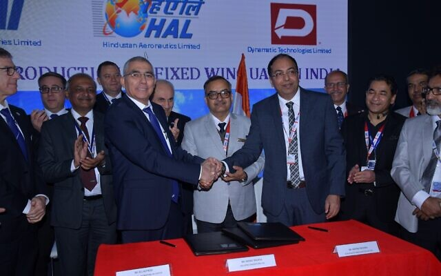 Officials at Israel Aerospace Industries (IAI) and India's Hindustan Aeronautics Limited (HAL) sign an MOU for the use and production of drones at the DefExpo 2020 exhibition, in Lucknow, India;, February 5, 2020 (Courtesy)