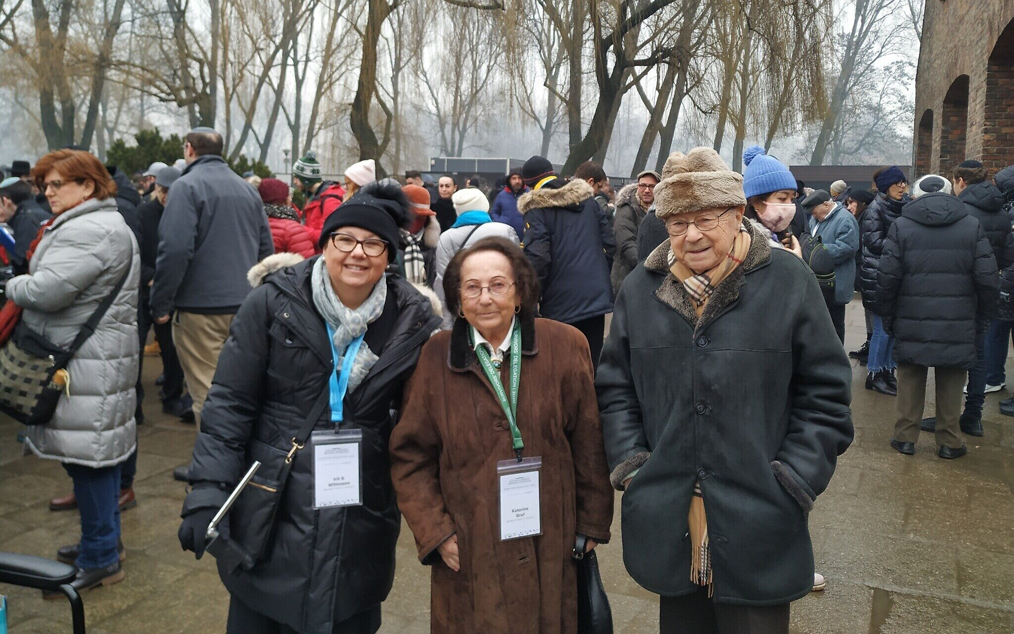 From left: Irit Wittmann, Katarina Graf, and Sol Graf pose in front of the Auschwitz-Birkenau Memorial and Museum, January 28, 2020. (Yaakov Schwartz/ Times of Israel)