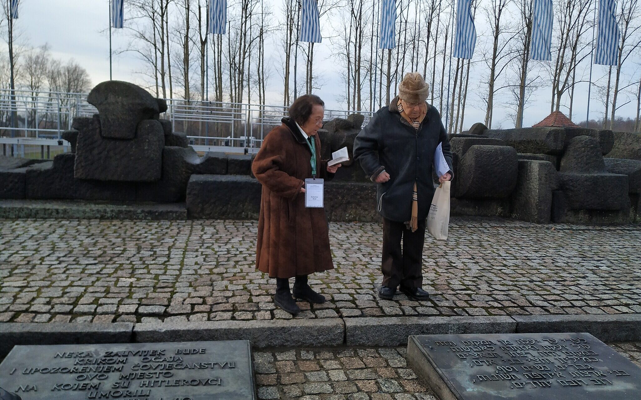 Sol and Katarina Graf near the memorial between the gas chambers and crematoria at the former Auschwitz II-Birkenau, January 28, 2020. (Yaakov Schwartz/ Times of Israel)