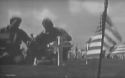 Screen capture from video of the dedication of Iwo Jima marines 5th Division cemetery, March 1945. (YouTube)