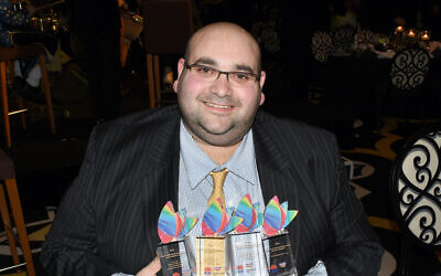 Australian Jewish News CEO Joshua Levi with his New South Wales Premier's Multicultural Media Awards. (Noel Kessel/courtesy)
