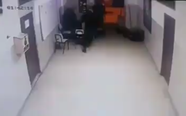 Security camera footage captures the moment after a Palestinian police officer is apparently shot by Israeli gunfire in the West Bank city of Jenin on February 6, 2020. (Screen capture)